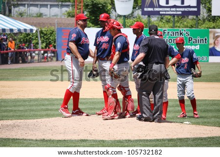 BINGHAMTON, NY - JUNE 14: The Reading Phillies have a conference on the mound during a game against the Binghamton Mets at NYSEG Stadium on June 14, 2012 in Binghamton, NY - stock photo