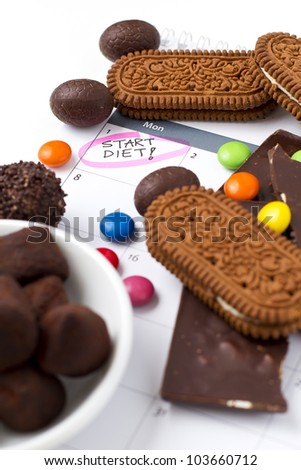 Binging on sweets just before the diet - stock photo
