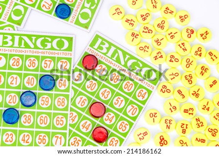 bingo card game waiting for only one chip to win isolated on white background - stock photo