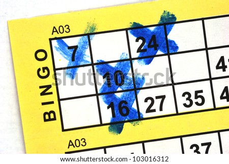 Bingo Card in Close up with numbers crossed - stock photo