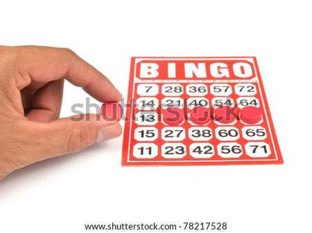 bingo card with hand hold wining chip - stock photo
