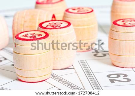 bingo cards and kegs closeup - stock photo