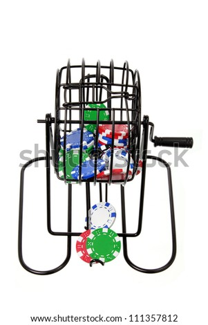 Bingo Game Cage with Poker Chips on White Background - stock photo