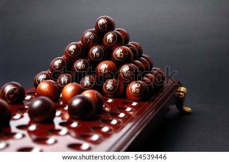 Bingo table whit  balls on pyramid - stock photo