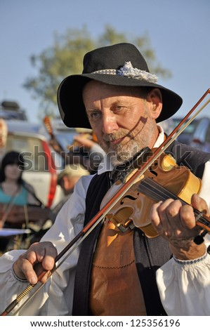 BINGSJO, SWEDEN - JULY 7: Unidentified man play the violin in music festival   in Bingsjo, official name Bingsjostamman organization are folkmusikens hus on July 7, 2010 in Bingsjo Sweden - stock photo