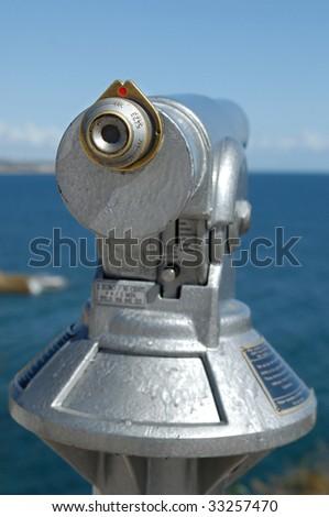 Binocular at the coast, looking to the horizon - stock photo