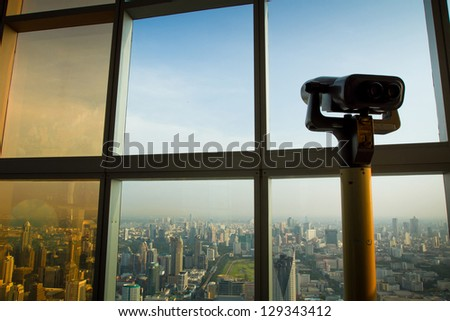binoculars and urban view, new vision in business, conceptual picture - stock photo