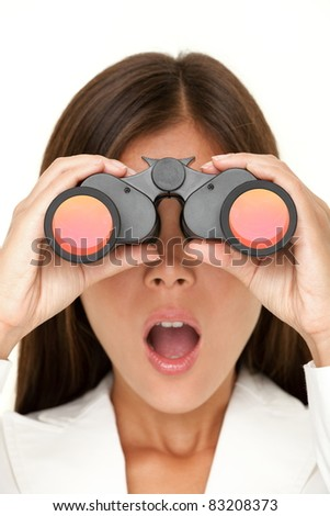 Binoculars woman looking surprised at camera - closeup of business woman in white suit looking. - stock photo