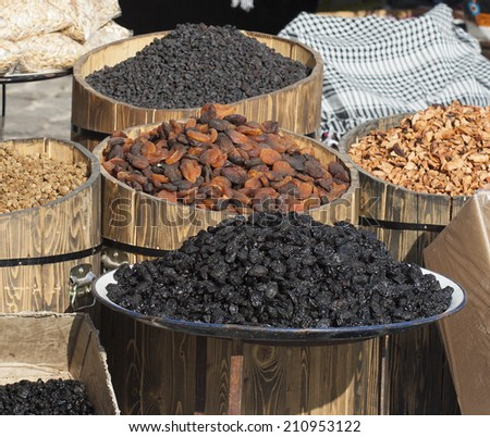 bins of dried fruit for sale in market - stock photo