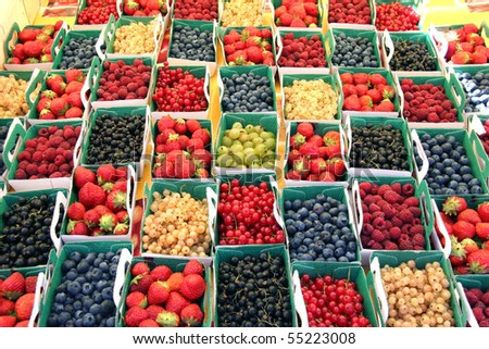 bio colorful berries at the market - stock photo