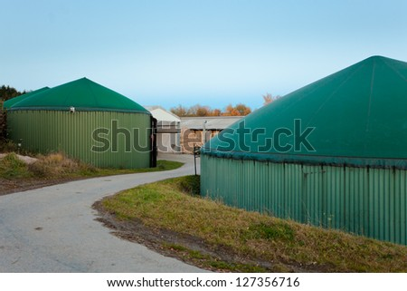 bio gas facility for biologically fermenting silage and other organic matter to biogas for environmental friendly energy generation to combat global warming - stock photo