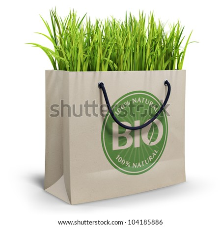 Bio 100% natural, shopping bag filled with grass, isolated on white background
