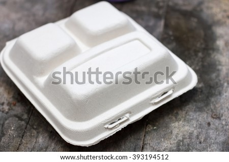 Biodegradable lunch box on the wood , food box made of paper - stock photo