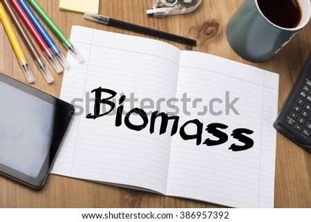 Biomass - Note Pad With Text On Wooden Table - with office  tools