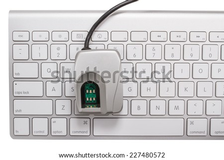 Biometric fingerprint scanner on a keyboard isolated on a white background - stock photo