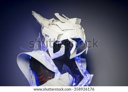 bionic armor with blue LED lights and plastic materials - stock photo