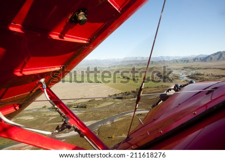 Biplane in Flight - stock photo