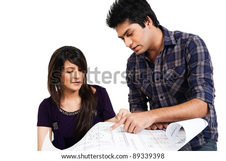 biracial couple, couple discussing the plan of a new house - stock photo