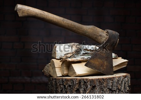 birch firewood, old rusty ax  - stock photo