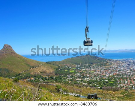 Bird-eye view at cable car cabin and Cape Town and Lion's peak from Table Mountain. Shot in Table Mountain (cable car area), Cape Town, South Africa. - stock photo