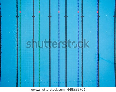 bird eye view of blue swimming pool with lane lines