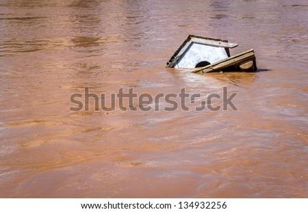 Bird house drown by a flood. - stock photo