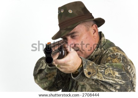 Bird hunter with shotgun taking aim - stock photo
