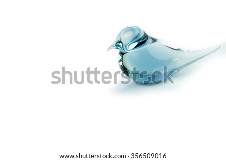 Bird made of glass figurine. With blue silhouette