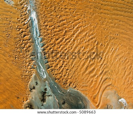 Bird's-eye view of river and desert in Namibia - stock photo