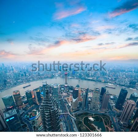 bird's eye view of shanghai panorama with beautiful sunset glow - stock photo