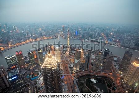 bird's eye view shanghai at dusk from world financial center - stock photo