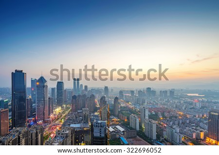 Bird view at Nanchang China. Skyscraper under construction in foreground. Fog, overcast sky and pollution. Bund (Nanchang) area - stock photo