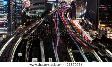 Bird view of Tokyo Station with train light trail at Night - stock photo