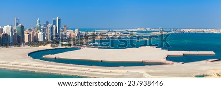Bird view panorama of Manama city, Bahrain. Skyline with modern skyscrapers standing on the coast of Persian Gulf - stock photo