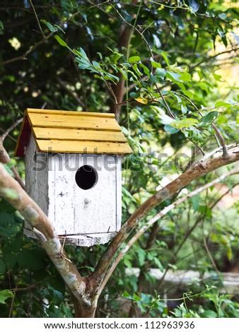 Birdhouse at home garden - stock photo
