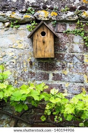 Birdhouse on a wall - stock photo