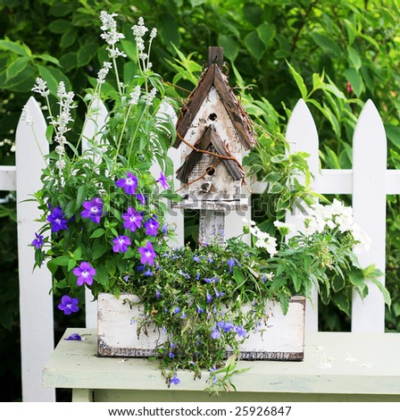 birdhouse planter on bench - stock photo
