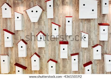 Birdhouses on the wall. Neighborhood and property concept - stock photo