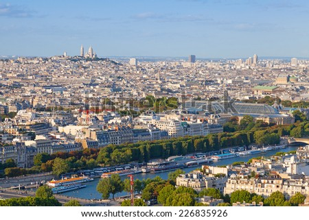 Birds eye view from Eiffel Tower on Paris city, France with Sacre Coeur cathedral on the horizon - stock photo