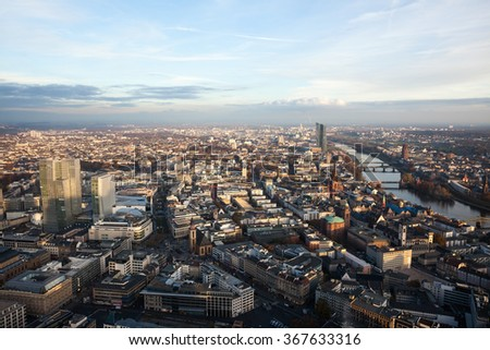 Birds eye view from high above Frankfurt Germany with downtown buildings and river reaching to the horizon during mid-morning