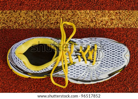 Birds eye view of a runner on red tartan surface - stock photo