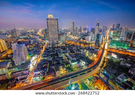 Birds eye view of Bangkok city night with a modern building at . Traffic in the business district  - stock photo