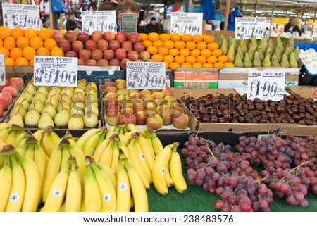 BIRMINGHAM, England - DECEMBER 13: A farmer market selling variety of fruits in Birmingham shopping centre christmas market, December 13, 2014. Birmingham City, England. Variety of fruits. - stock photo