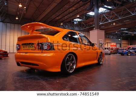 BIRMINGHAM, ENGLAND, JULY 5: Orange Ford Escort Cosworth on Display at the Annual StreetLife Car Show on July 5, 2008 in Birmingham, England, UK.  Birmingham NEC is host to the show - stock photo