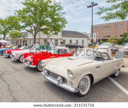 BIRMINGHAM, MI/USA - AUGUST 16, 2014: Four Ford Thunderbird cars at the Woodward Dream Cruise, the world's largest one-day automotive event. Woodward is a National Scenic Byway. - stock photo
