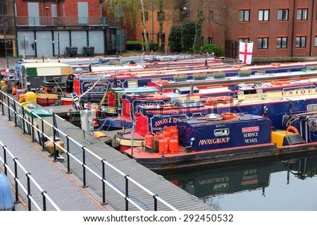 BIRMINGHAM, UK - APRIL 24, 2013: Narrowboats moored at Gas Street Basin in Birmingham, UK. Birmingham is the 2nd most populous British city. It has rich waterway and boat culture. - stock photo