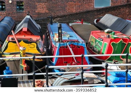 BIRMINGHAM, UK - APRIL 19, 2013: Narrowboats moored at Gas Street Basin in Birmingham, UK. Birmingham is the 2nd most populous British city. It has rich waterway and boat culture. - stock photo