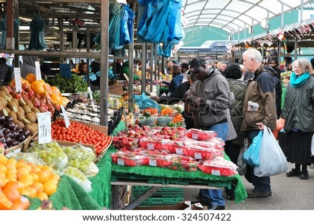 BIRMINGHAM, UK - APRIL 19, 2013: People visit market place in Birmingham, UK. With 1.09 million residents it's the 2nd most populous city in the UK. - stock photo