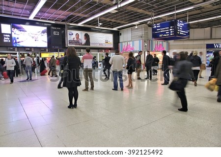 BIRMINGHAM, UK - APRIL 19, 2013: People wait at New Street station on April 19, 2013 in Birmingham, UK. With 31.2m annual passengers (2012) it is 8th busiest station in the UK. - stock photo