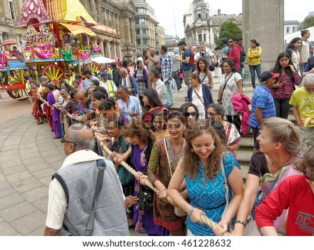 BIRMINGHAM UK - JULY 24: The cart festival called 'Ratha yatra' in Birmingham July 24, 2016. Everybody can pull the ropes on the cart with the Lord Jagannatha, on the Victoria Square.